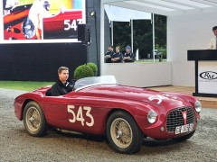 The record-setting 1952 Ferrari 212 Export Barchetta crosses the podium at RM Sotheby's Villa Erba sale
