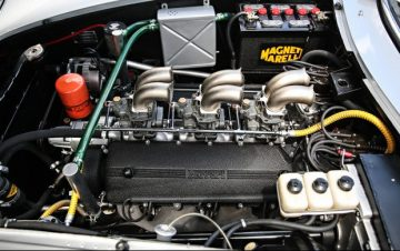 The engine bay of chassis 09051 and its unique three Weber 40 DFI carburetor setup